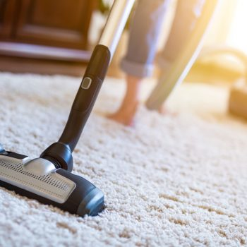 Vacuuming Carpet Under Bed - J & R's Carpet Cleaning